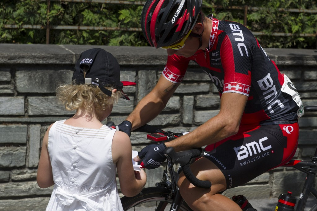 Team BMC rider signing autograph for small child