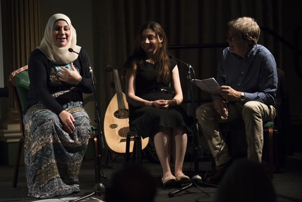 Foutoun Dasouki (left) being interviewed by Richard Trayler-Smith with the aid of translator Nour Alhusein (middle)