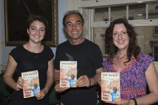 Kae Bahar (centre) with his daughter Tashan (left) and wife Josie (right)