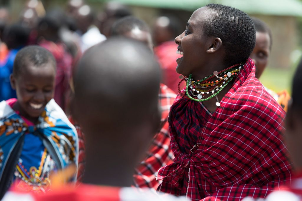 Pupils of Emanyatta Secondary School sing and dance as they welcome Philip and Ellie with a Maasai ceremony.